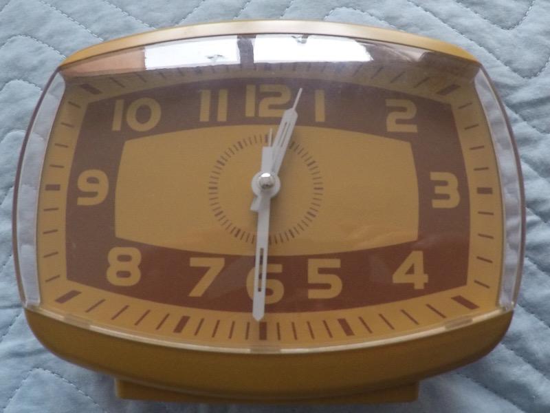 Relógio e foto da blogueira